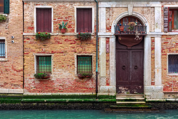 Facade of typical brick building in Venice, Italy.