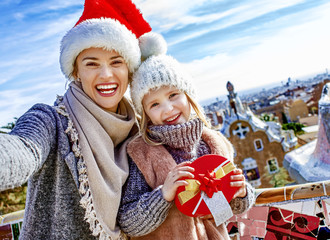 mother and daughter at Guell Park at Christmas taking selfie