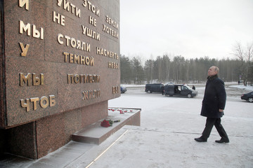 Russian President Vladimir Putin visits a monument at Nevsky Pyatachok, an area southeast of St. Petersburg, in Leningrad region