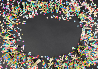 carnival background black with streamer and confetti