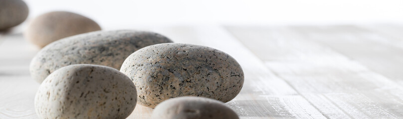 pebbles for spirituality, ayurveda, mineral spa or mindfulness, long banner