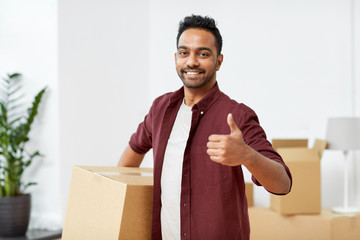 man with box moving to new home showing thumbs up