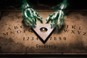 Talking board with a ghost touching the planchette, high contrast image
