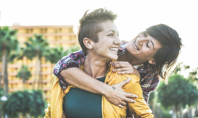Happy gay couple having fun together outdoor - Young women having a date