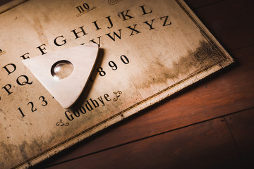 Talking board and planchette used on seances for communicating with the dead, high contrast image