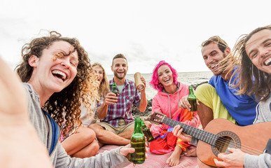 Adult friends takins selfie with smartphone camera at beach party outdoor - Happy people having fun playing music and drinking beer - Focus on center guys - Technology trends and friendship concept