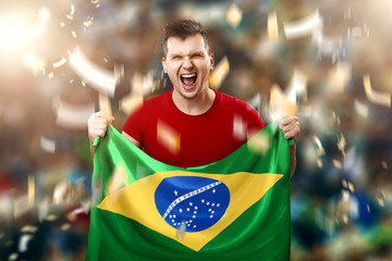 Brazilian fan, fan of a man holding a national flag Brazil in the hands. Soccer fan in the stadium. Mixed media
