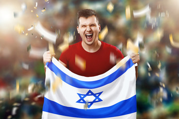 An Israeli fan, a fan of a man holding the national flag of Israel in his hands. Soccer fan in the stadium. Mixed media