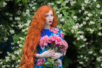 Red haired woman with flowers