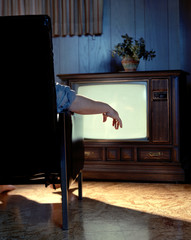 Hand with TV