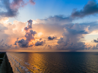 An aerial stormy beach sunrise with beautiful colors.