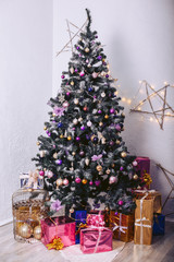 Christmas tree with gift boxes and decorative elements