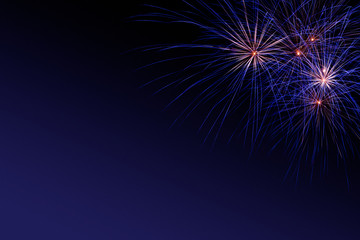 Colorful firework on the night sky. New Year celebration fireworks. Abstract firework isolated on black background with free space for text