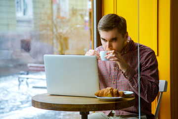 man hand use laptop connecting wifi internet businessman busy office desk finger typing computer sitting wooden table cafe coffee croissant