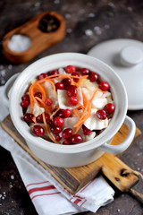 White cabbage marinated with carrots, apples and cranberries.