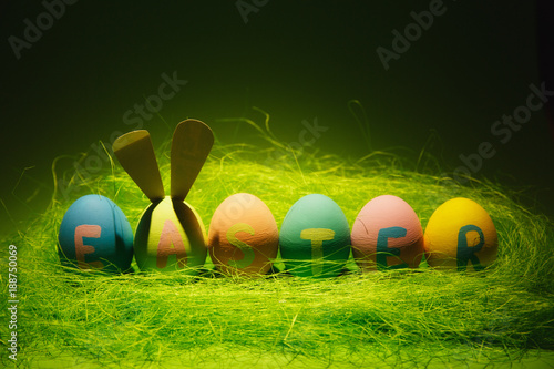 row of six colorful pastel monophonic painted easter eggs with