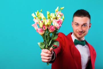 .man holding flowers on Valentine's Day, turquoise background
