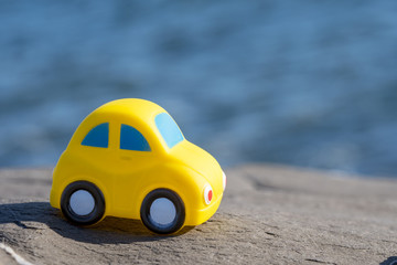 Toy Car near the sea. Travel, tourism, holiday and adventure concept.