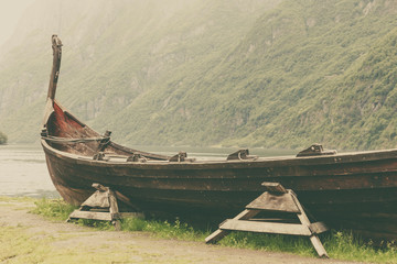 Old wooden viking boat in norwegian nature