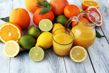 Citrus background. Assorted fresh citrus fruit. Lemon, orange lime, grapefruit. Fresh and colorful concept.