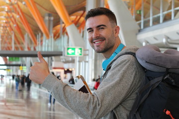 Satisfied traveler giving a thumbs up from the airport