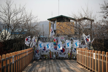 A unification flag hangs on a military fence near the demilitarized zone (DMZ) separating the two Koreas in Paju
