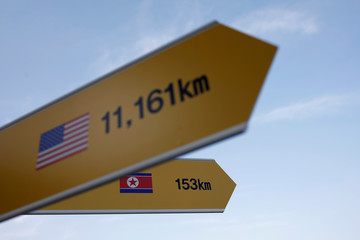 A directional sign bearing North Korean and U.S. flags is seen near the demilitarized zone separating the two Koreas in Paju