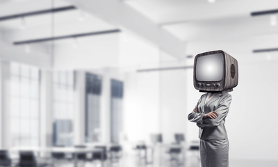 Business woman with old TV instead of head.