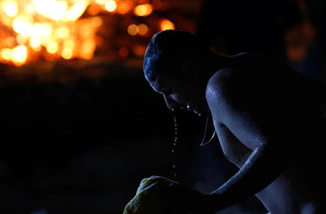 A man exits the water during Orthodox Epiphany celebrations in the village of Drachevo, outside Moscow, Russia