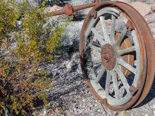 Old tires with metal Wagon wheel spikes in the desert in Arizona in a deserted ghost mining town.