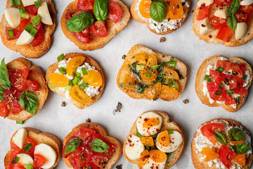 Tasty bruschettas with tomatoes on table, top view