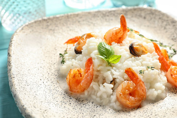 Plate with tasty seafood risotto, closeup