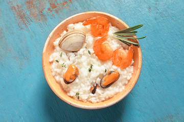 Dish with tasty seafood risotto on table