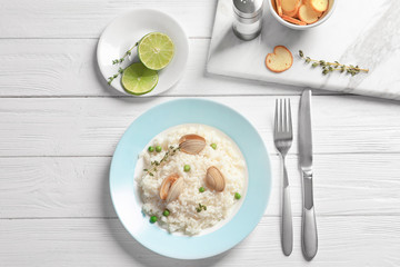 Plate with tasty seafood risotto on table