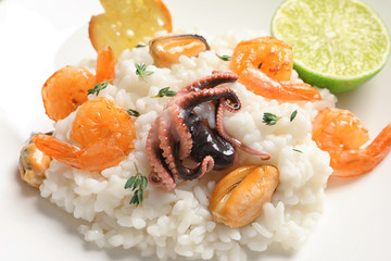 Tasty seafood risotto on light background, closeup