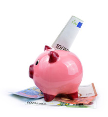 Pink piggy bank and euro banknotes isolated on a white background. Concept of saving money.
