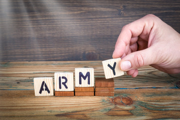 army. Wooden letters on the office desk, informative and communication background.