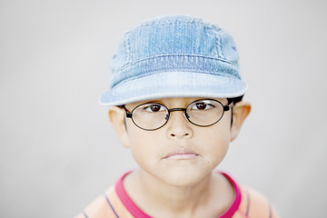 Portrait of boy in glasses and hat