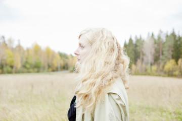 Profile of blond woman in field