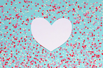 Background of colorful hearts with paper heart for text