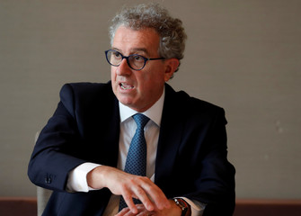 Luxembourg's Finance Minister Pierre Gramegna speaks during an interview with Reuters in Tokyo
