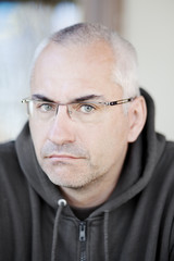 Portrait of adult man wearing glasses
