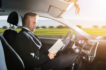 Businessman Sitting Inside Self Driving Car