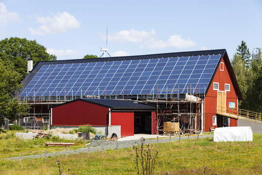 Barn with solar panels and ongoing construction work