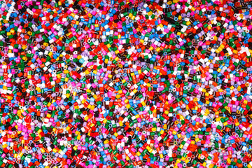 Background of multicolored decorative plastic craft beads.