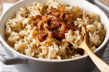 Vegetarian food: rice with lentils and caramelized onion macro. horizontal