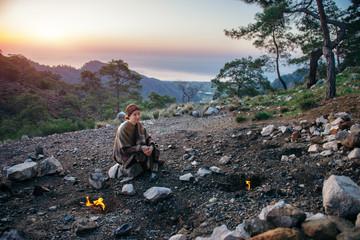 Traveler regaining her strength at Yanartash at sunset in Turkey