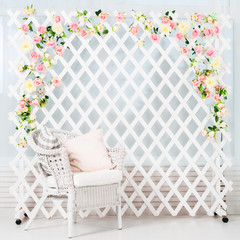 Light interior decorated with chair and white fence with flowers. Concept of wedding, marriage