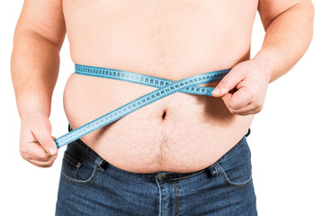 Man measuring his fat belly with measurement tape