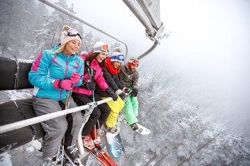 Cheerful  skiers in ski lift